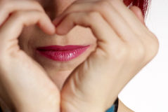 Woman shows heart Stock Photography