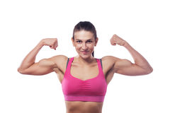 Woman  shows her bicep. A woman in pink sports clothes shows her bicep. Isolated white background Stock Photography