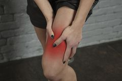 Woman shows that her calf hurts stock photo