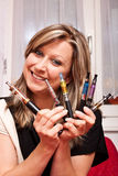 Woman shows her collection electric cigarettes Stock Photos