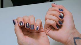 Woman shows her new manicure. Purple nail royalty free stock photo