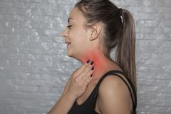 Woman shows that her throat hurts. Woman shows, that her throat hurts Stock Photography