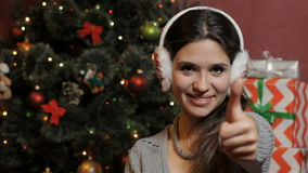 Woman shows her thumb up near the christmas tree stock video