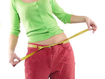Woman shows her weight loss by wearing an old big trousers. Stock Photo