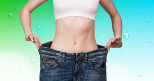 Woman shows her weight loss Royalty Free Stock Photo