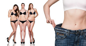 Woman shows her weight loss Stock Photography