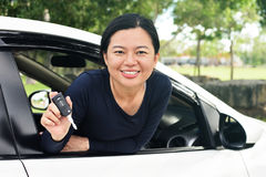 Woman shows the keys to her new car stock photo