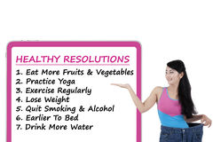 Woman shows the list of healthy resolutions Stock Image