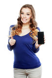 Woman shows a look at a smartphone Royalty Free Stock Photos