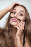 Woman shows mustache Royalty Free Stock Photos