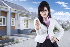 Woman shows a new house key Stock Photo