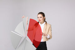Woman shows a pie chart, circle diagram. Business analytics concept. Young Businesswoman shows a pie chart circle diagram. Business analytics concept Royalty Free Stock Images