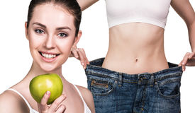 Woman shows results of diet wearing big jeans Stock Images