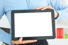 Woman shows screen of digital tablet. Royalty Free Stock Photo