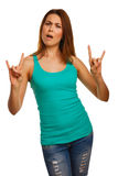Woman shows sign devil rock metal in vest Stock Photography