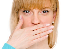 Woman shows sign of silence. Secret woman. woman shows hush be quiet. isolated on white background Royalty Free Stock Image
