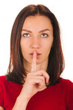 Woman shows sign of silence. Secret woman. woman shows hush be quiet. isolated on white background Stock Photography