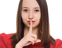 Woman shows sign of silence. Secret woman. woman shows hush be quiet. isolated on white background Royalty Free Stock Photos