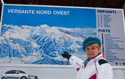 Woman shows the slopes of the resort map Royalty Free Stock Photo