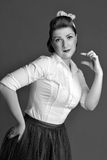 Woman shows small size. In retro style Royalty Free Stock Photos