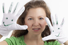 Woman shows smileys with her hands Royalty Free Stock Image