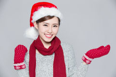 Woman shows something at Christmas Royalty Free Stock Photos