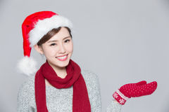 Woman shows something at Christmas Royalty Free Stock Photo
