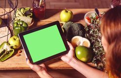 Woman Shows Tablet at Kitchen Table Stock Photos