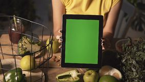 Woman Shows Tablet at Kitchen Table stock footage