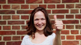 Woman shows a thumbs-up stock footage