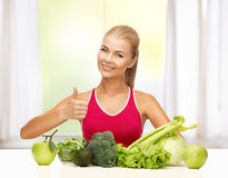 Woman shows thumbs up with organic food Stock Photo
