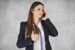 Woman shows thumbs up for telephone service stock images