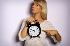 Woman shows the time Stock Photography