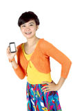 A woman shows a touch screen mobile phone. A beautiful woman shows a touch screen mobile phone in his hand isolated on white background Royalty Free Stock Image