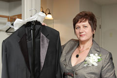 Woman shows tuxedo Royalty Free Stock Image
