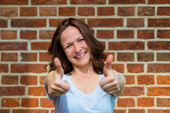 Woman shows two thumbs up Stock Photo
