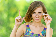 Woman shows up with his finger Stock Photography