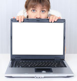 Woman shows us a blank computer screen Stock Photo