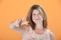 Woman Shows The Victory Symbol Stock Photos