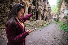 Woman shows way using mobile maps Stock Images