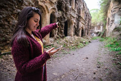 Woman shows way using mobile maps Stock Photos