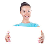 Woman shows white  tablet Royalty Free Stock Image