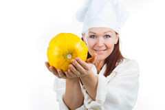 The woman shows a yellow melon Stock Photos