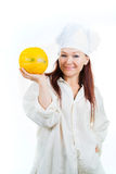 The woman shows a yellow melon Royalty Free Stock Image