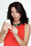 Woman shows your phone Royalty Free Stock Photography
