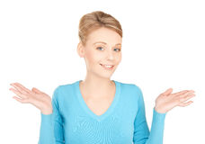 Woman shrugging or doubting Stock Images