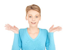 Woman shrugging or doubting Stock Image