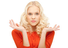 Woman shrugging helpless with her shoulders Royalty Free Stock Photography