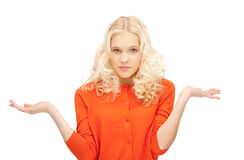 Woman shrugging helpless with her shoulders Stock Photo
