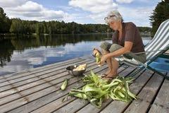 Woman shucking corn Stock Images